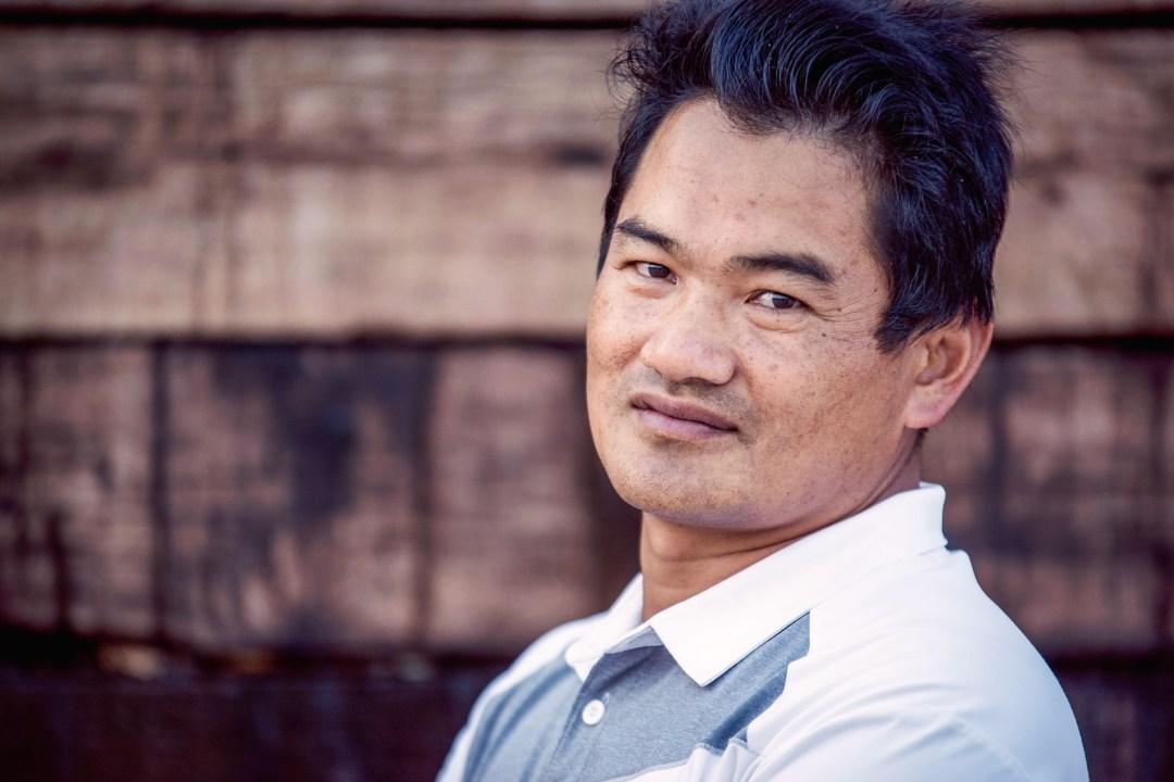 Mr. Li, a coffee and tea farmer from Yunnan, China