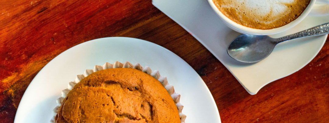 Photo of a Bananna muffin and a latte at Zuela's Guesthouse in Luang Namtha, Laos