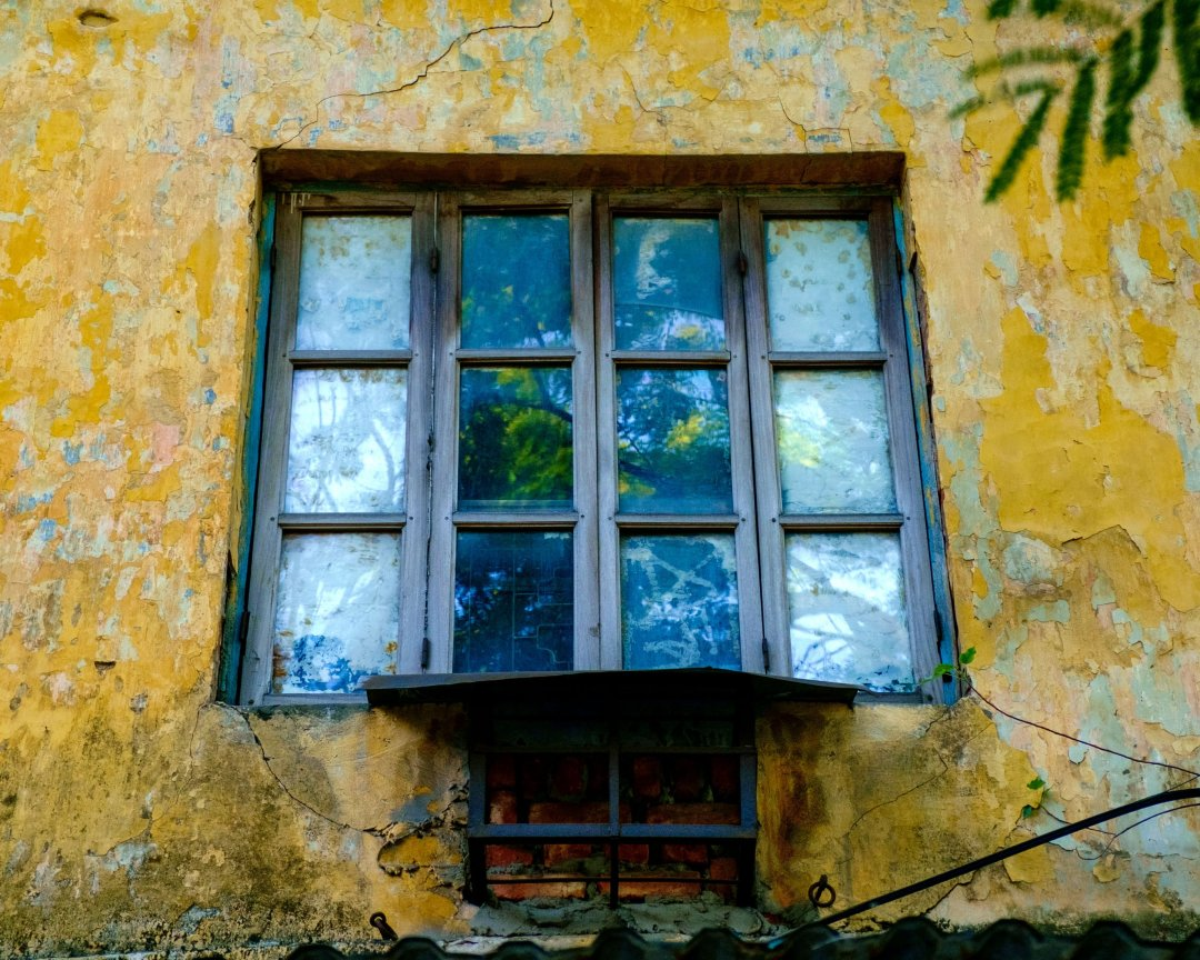 Window in a yellow wall - Old French Quarter, Hanoi, Vietnam