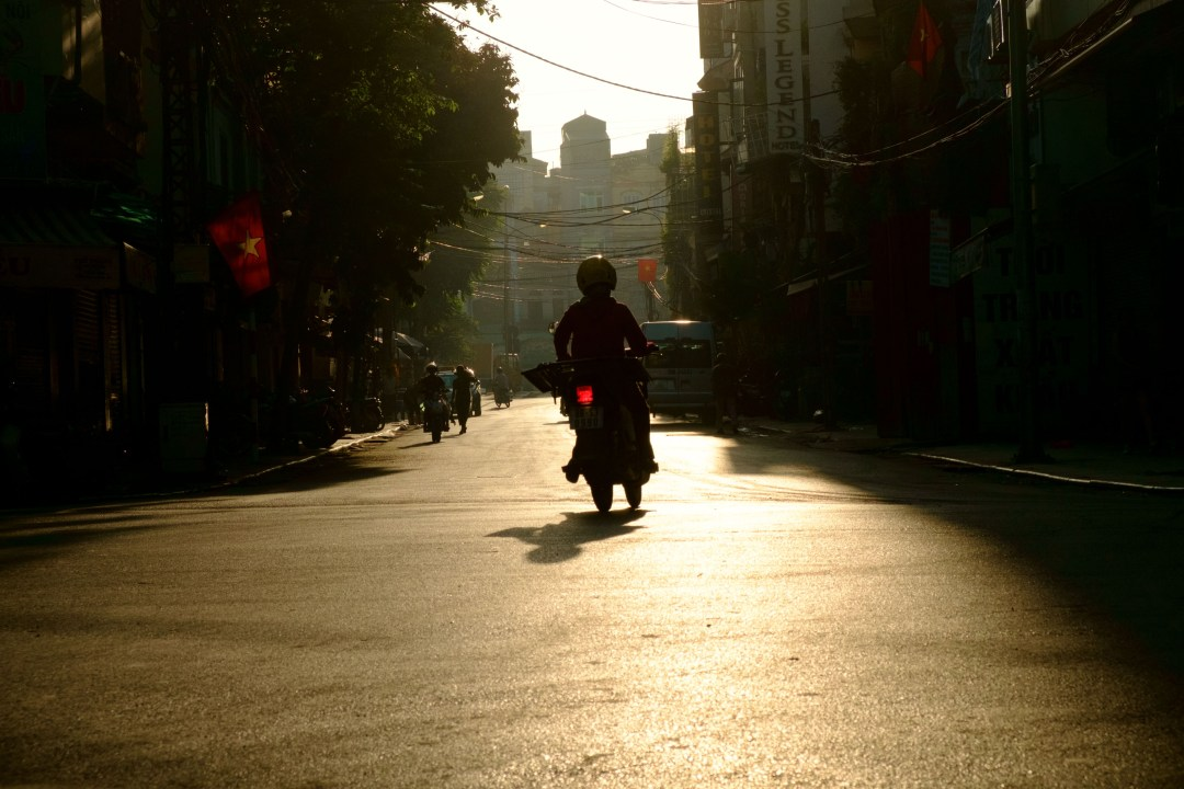 Silhouette of a motorcycle, Old French Quarter, Hanoi, Vietnam