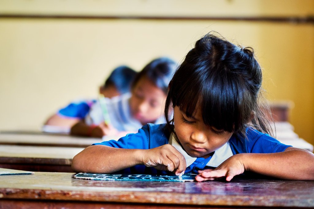 Photo of girls studying in a Cambodian school by Humanitarian Photographer Bryon Lippincott