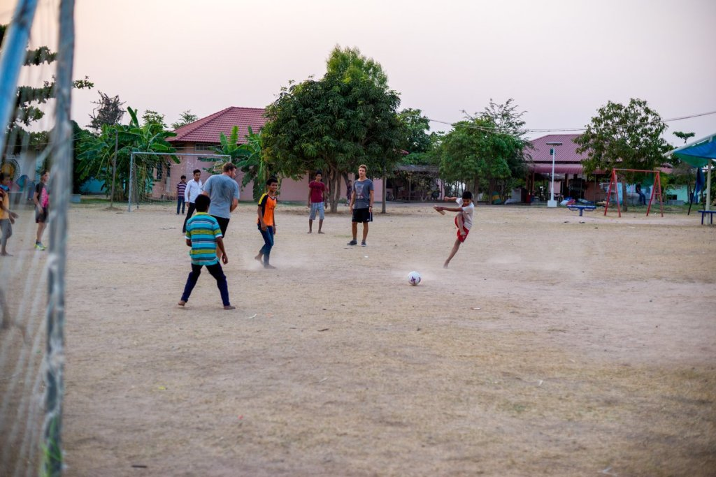 photo of children playing soccer by humanitarian photographer Bryon Lippincott