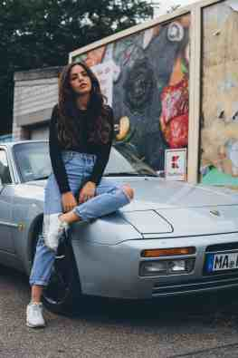 Porsche 944 with Woman Sitting on Hood