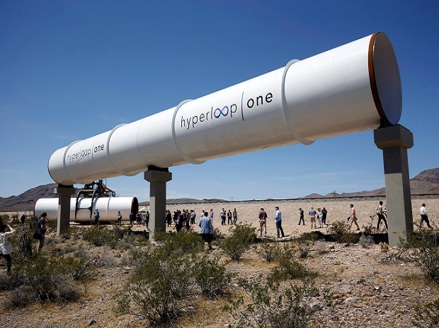 TUBE TRAVEL: A file picture of journalists and guests look at tubes following a propulsion open-air test at Hyperloop One in Las Vegas, Nevada, US. Photo: Reuters