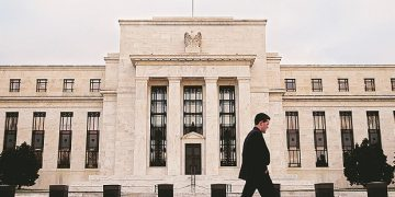 US Fed minutes show rates on hold until economy shows 'materials change