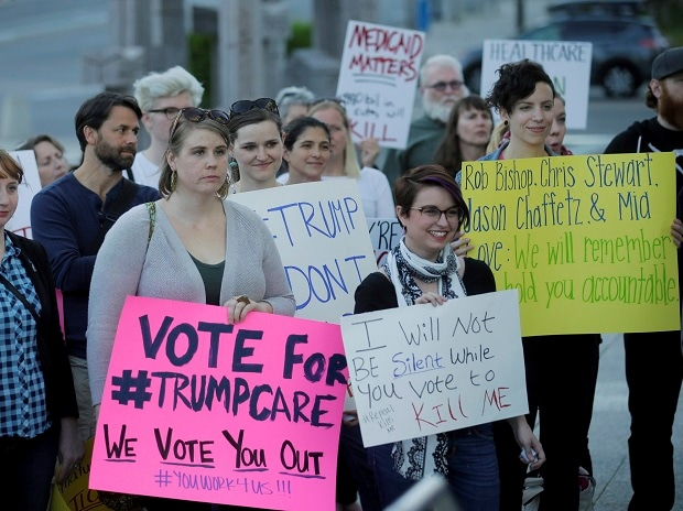 People look on during a healthcare rally Thursday, May 4, 2017, in Salt Lake City. Utah's all-Republican House delegation voted Thursday in favor of a health care overhaul that could impact people with pre-existing conditions, triggering serious worr