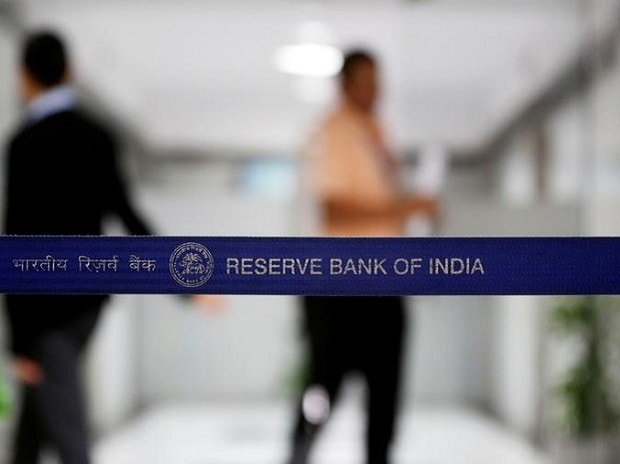 People walk past a barricade inside the Reserve Bank of India (RBI) headquarters in Mumbai. (Photo: Reuters)