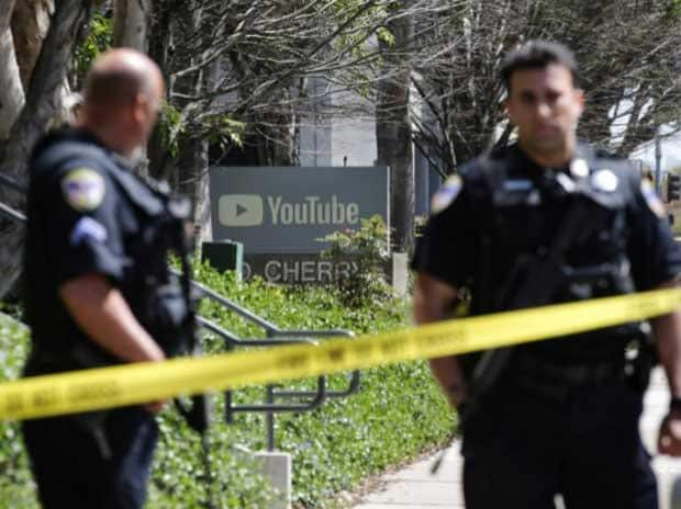 Police officers and crime scene tape are seen at Youtube headquarters following an active shooter situation in San Bruno, California, US