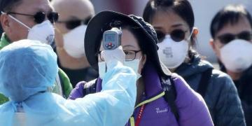 China reports fall in new virus cases but concerns grow over rising spread
