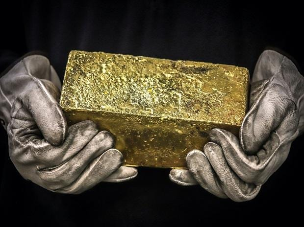 Gold prices hover near ,900/ounce on subdued US dollar, bond yields