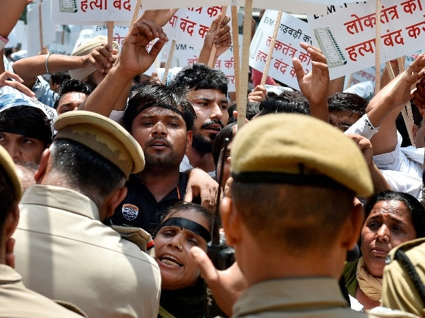 Police stop AAP workers protesting over alleged tampering of EVMs outside the office of Election Commission of India in New Delhi on Thursday. (Photo: PTI)