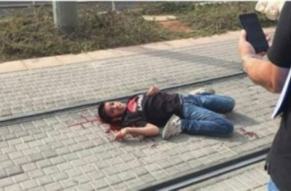 Ahmad Manasra, a 13-year-old Palestinian boy, lying on the ground, bleeding from multiple gunshot wounds