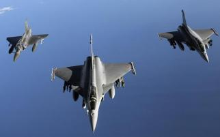 French military jets are seen in this 2011 file photo. French officials announced that that country's forces had launched their first air strikes against the Islamic State group in Syria on Sunday. Getty Images
