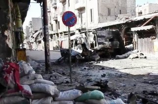 Bombed out vehicles in Aleppo, Syria. 6 October 2012 (Wikipedia)