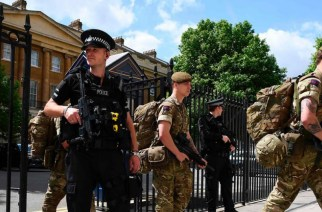 British soldiers arrive at a Ministry of Defence building near to New Scotland Yard police headquarters, London, 24 May. Photograph: Justin Tallis/AFP/Getty Images