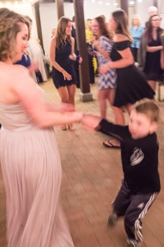 Sister of the bride with her son dancing.