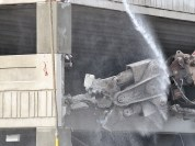 Thursday morning, Sept. 26, was the first day of visible demolition of the 4th Street parking garage. (Dave Askins/Beacon)