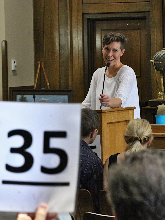 Monroe County's treasurer, Jessica McClellan, auctions off property at the tax sale held Oct. 10, 2019 (Dave Askins/Beacon)