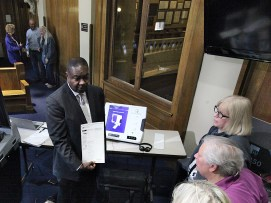 Willie Wesley of ES&S demonstrates his company's voting equipment for county officials. (Dave Askins/Beacon)