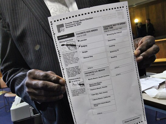 Willie Wesley, with ES&S, displays a ballot with the kind of voter intent issue that is eliminated with electronic marking of ballots. (Dave Askins/Beacon)