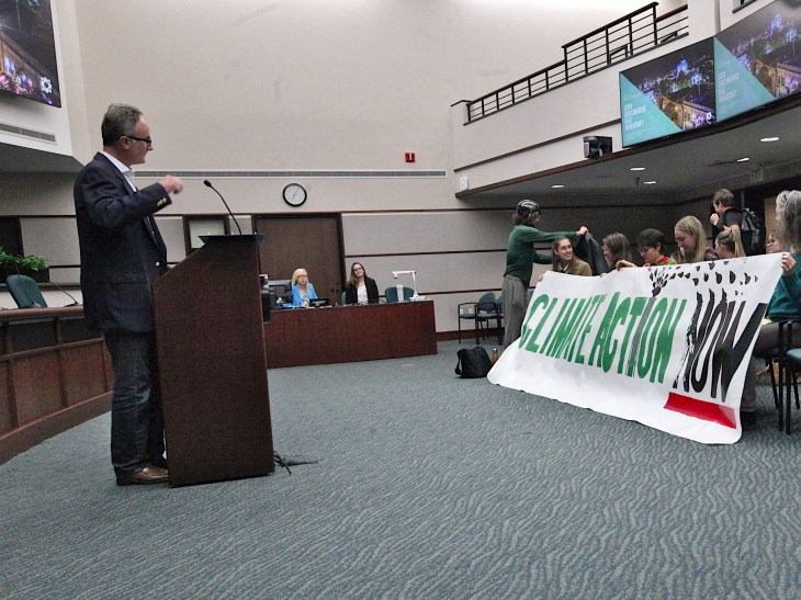 Bloomington's director of economic and sustainable development, Alex Crowley at the podium. (Dave Askins/Beacon)