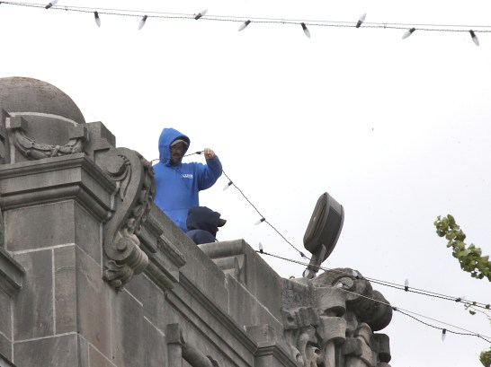 View from the southeast of workers atop the Monroe County courthouse stringing lights on Tuesday, Oct. 22, 2019. (Dave Askins/Beacon)
