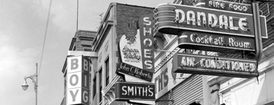Examples of projection signs on Walnut between Kirkwood and 6th Street from 1963.