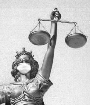 cropped small masked lady-justice-statue