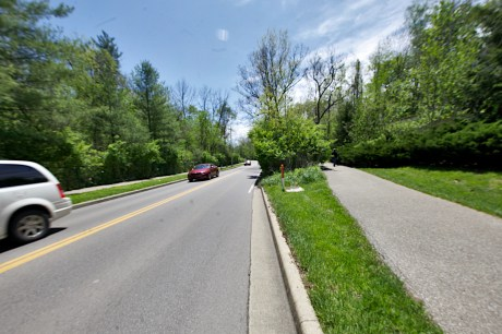 Looking south on Sare Road. The path in the right of the frame currently veers away from the road through a wooded area. It would be extended along Sare Road as a part of a planned project.