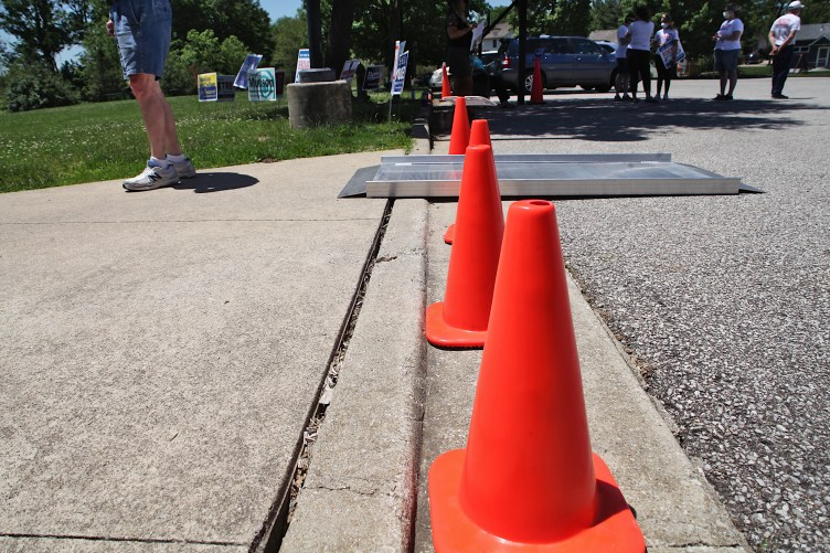 Low curb at Grandview Elementary School, which was bridged with a portable ramp.