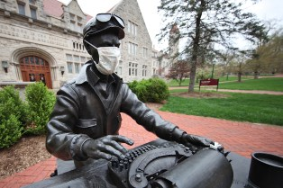 """File photo from April of Ernie Pyle statute on IU campus. """"Fine. Put a mask on my statue, but please don't put words in my mouth."""""""