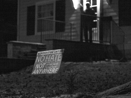A sign in Bloomington mayor John Hamilton's front yard on Jan. 17, 2021. Hamilton is standing on the porch in the background.