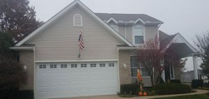 picture of a beige house that had brightside restoration soffit installation in medina ohio