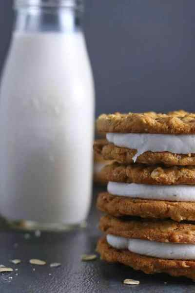 Homemade Oatmeal Cream Pies stack with a glass of milk
