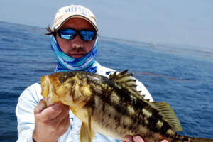 Capt. Vaughn Podmore with a nice calico bass