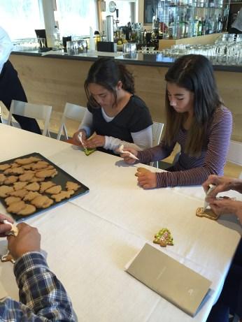 Mikaela and Kari decorating cookies