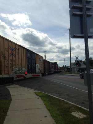 A freight train thunders through the town center. Photo by Kate Abbott