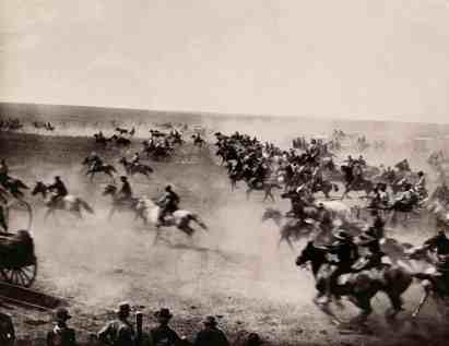 Riders race through the Cherokee Strip. Cherokee Outlet, Oklahoma, undated. Photo by Tulsa Chamber of Commerce, National Geographic Stock. Part of the exhibition National Geographic Greatest Photographs of the American West.