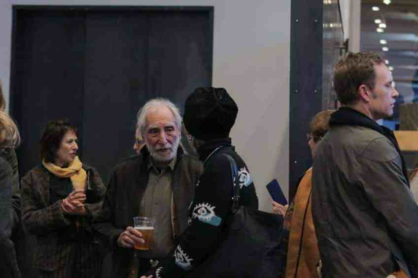 Richard Nonas' speaks with visitors as 'The Man in the Empty Space' opens at Mass MoCA. Photo by Nooshig Varjabedian, Courtesy of Mass MoCA