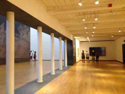 Visitors enter Mass MoCA from the lobby and stop by Clifford Ross's wave photos. Photo by Kate Abbott