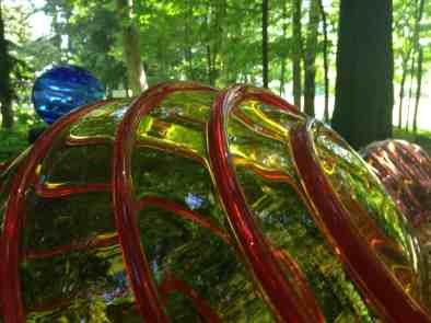 """A blown glass globe in Richard Royal's """"Optic Lens"""" reflects the trees at Chesterwood. Photo by Kate Abbott"""