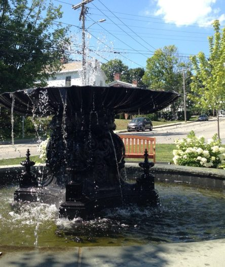 A fountain plays in the center of the village. Photo by Kate Abbott