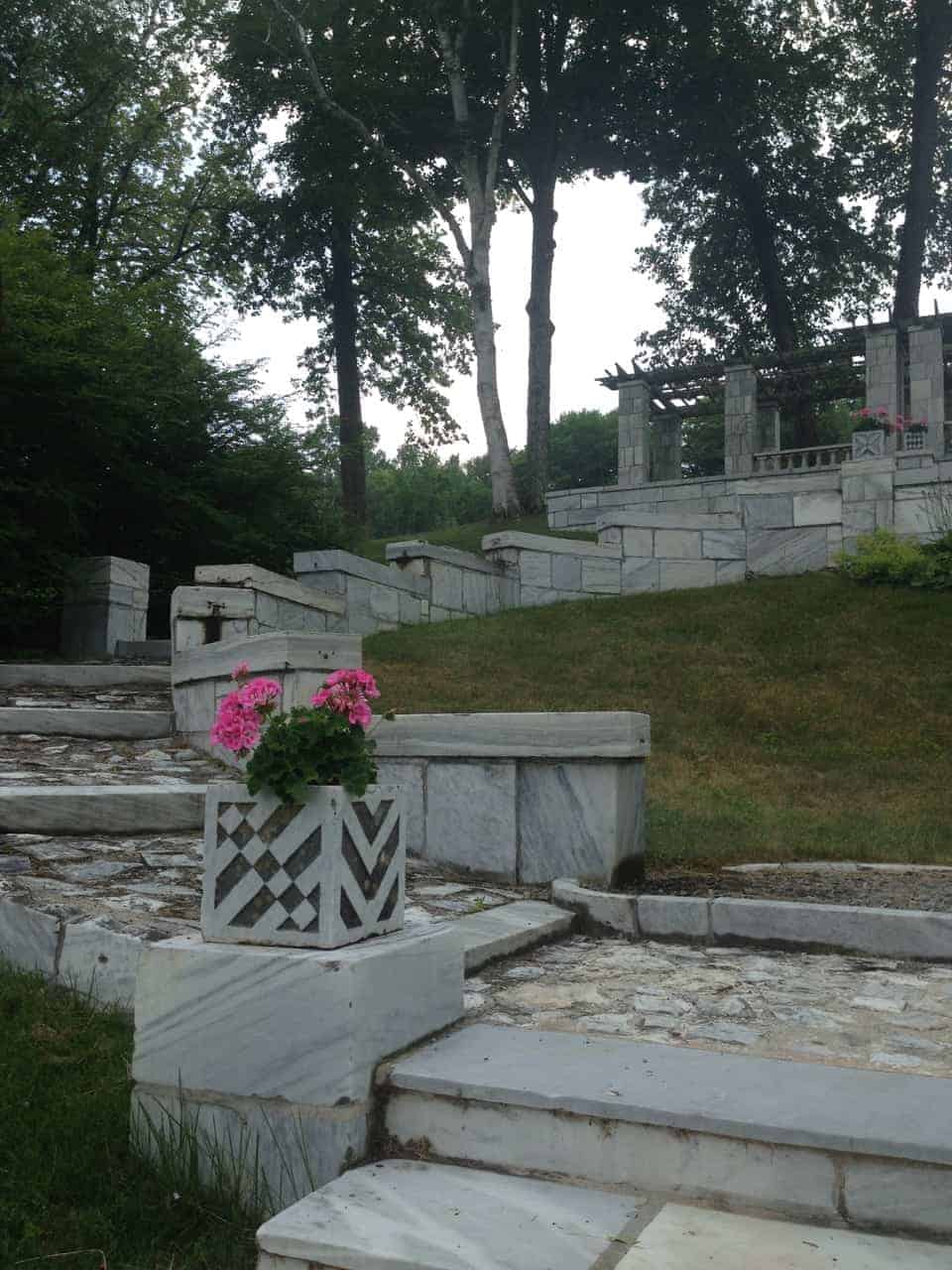 Marble steps and planters lead up the hill to a collonade. Photo by Kate Abbott