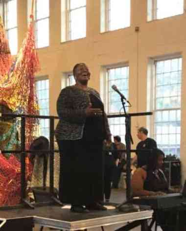 Brenda Wimberly sings in the gallery at the opening of Nick Cave's 'Until' at Mass MoCA. Photo by Kate Abbott