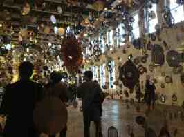 Visitors gaze into the gilltering room at the opening of Nick cave's 'Until' at Mass MoCA. Photo by Kate Abbott