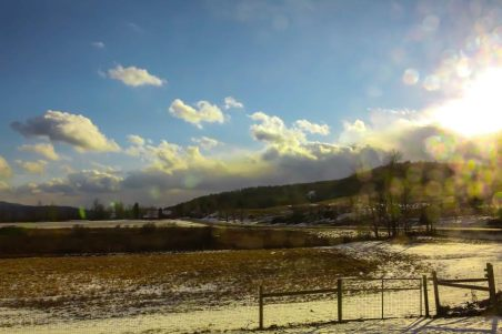 The sun glints on fields in winter. Photo by Jon Katz, courtesy of Hubbard Hall
