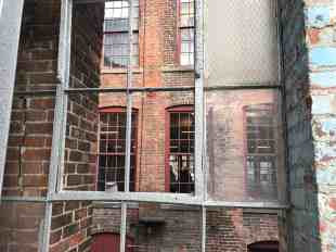 Windows look across Mass MoCA's inner courtyards. Photo by Kate Abbott