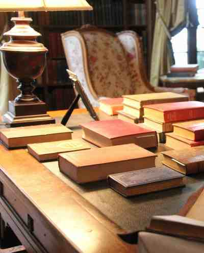 Edith Wharton's books line tables and shelves in her library at The Mount. Photo by Susan Geller