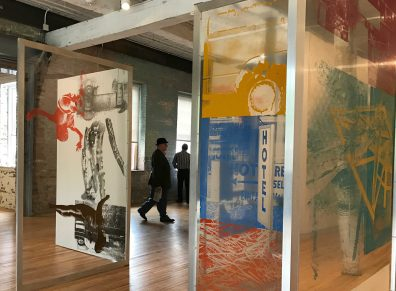 Robert Rauschenberg's labyrinth of collaged panels stands at the entrance to the new Building 6. Photo by Kate Abbott