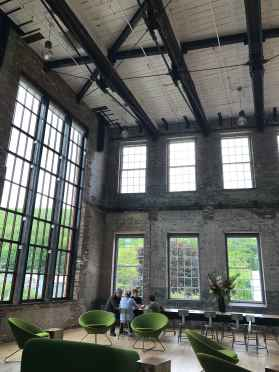 Visitors rest in the prow of the new Building 6 at Mass MoCA. Photo by Kate Abbott